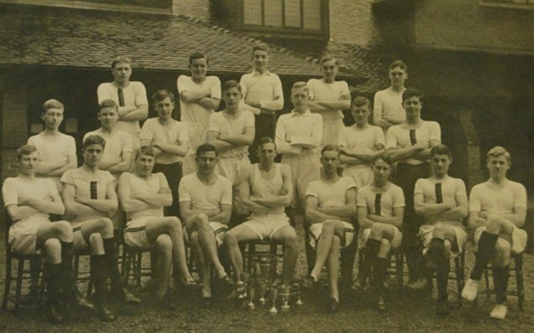 Alan Penington in the 1934 athletics team at Berkhamsted School (centre behind cups)