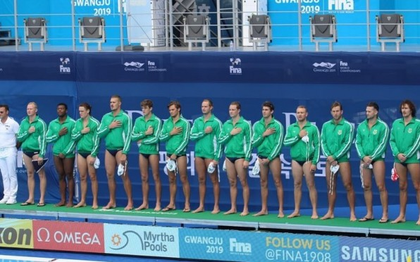 Liam Neil (third from left) sings the national anthem at the FINA World Aquatics Championships