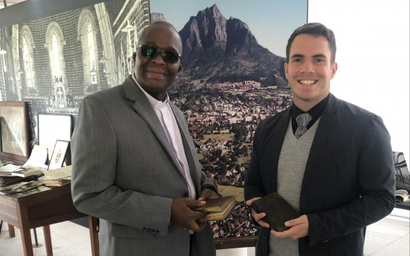 Fr Monwabisi (L) and Youth Pastor Justin (R) each having received a Bible from the Museum.