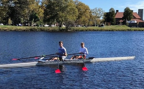boys training on the Charles River in Boston in preparation for the Head of the Charles Regatta