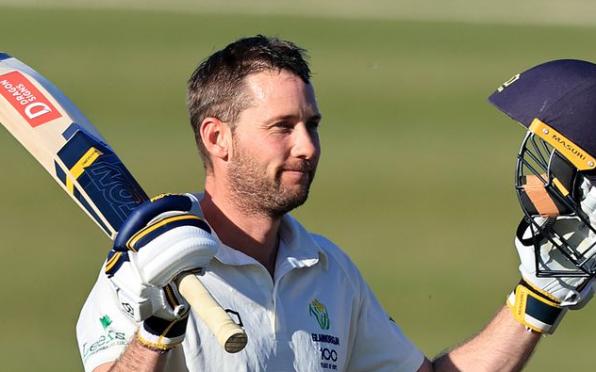 Glamorgan's Chris Cooke celebrates his century against Northamptonshire