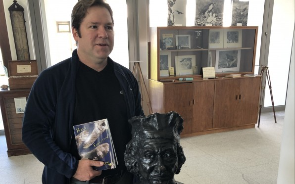 Dr Mark MacGregor in the Museum, beside the statue by Dr Garth Hockly of Rembrandt van Rijn.
