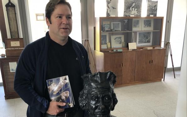 Dr Mark MacGregor in the Museum, beside the statue by Dr Garth Hockly of Rembrandt van Rijn.