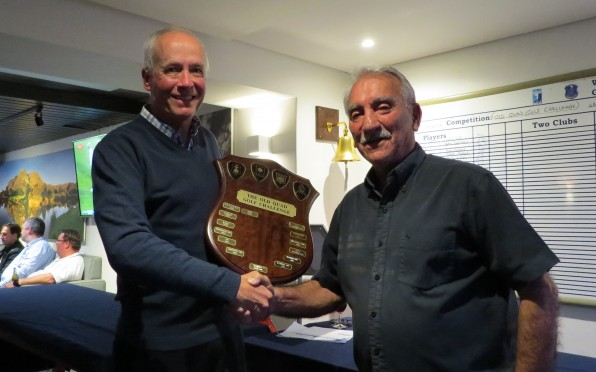 John Smuts (1969S) hands the Shield to Wynberg Captain Jeff Sternslow