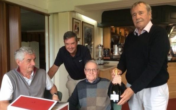 Stuart Findlay presenting champagne to John Hickling