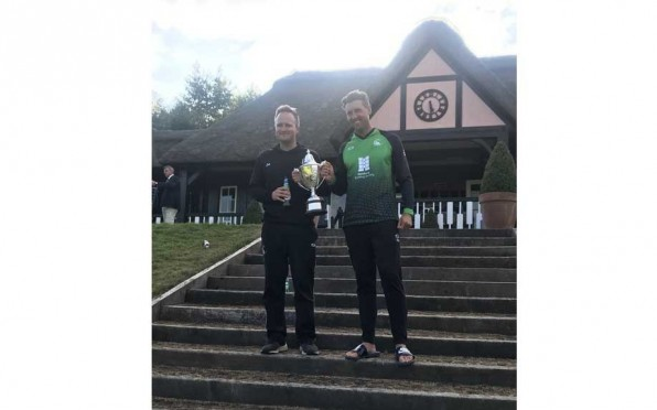 James and Richard Morris with the trophy
