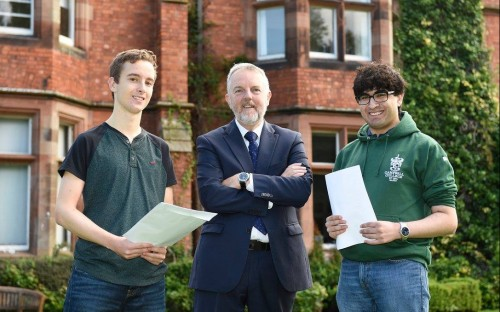 Pictured are Mohammad Rashid (right) and Thomas Gillan who each achieved 4A*s with Mr Robert Robinso
