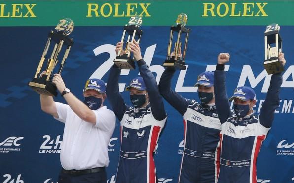 Phil Hanson (2nd Left) Celebrating