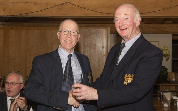 Dave Tooze presents the winner's prize to Bob Jennings