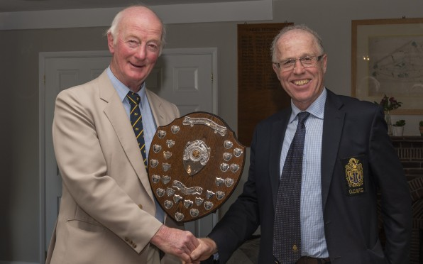 Dave Tooze receiving the Spring Shield from Bob Jennings