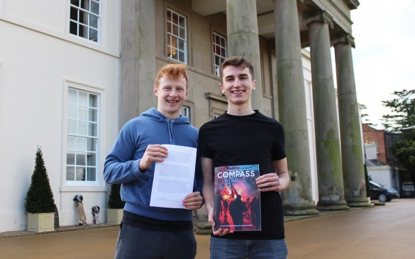 Pictured: Robbie (left) and Ben (right) hold their entries and magazine.