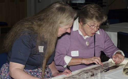Old Girls examine a photo after last year's AGM