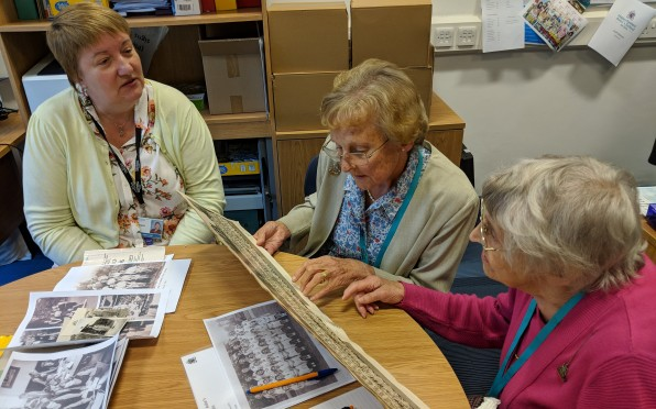 Shirley (right) and Cynthia (middle) looking at archive material with Archivist Judith Curati