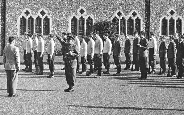"""RSM Saunders appears to be giving the CO Captain """"Bum"""" Bailey a salute"""
