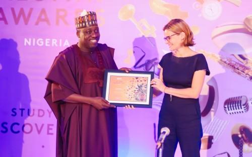 Bolaji receiving his finalist certificate; British Council