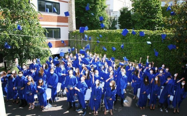 The blue caps were in the air again this May, when our Class of 2021 celebrated their graduation!