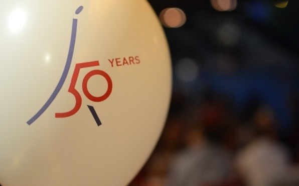 The anniversary logo was created by a student and chosen through a school-wide design competition