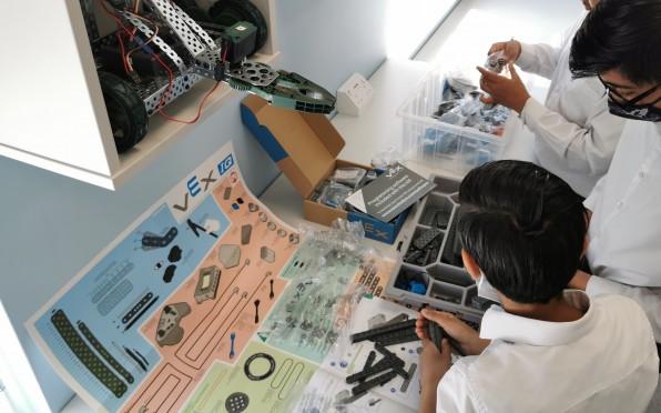 Year 8 pupils preparing to open the brand new VEX robotics kits!