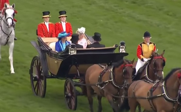 Lucy in her royal attire (back right)