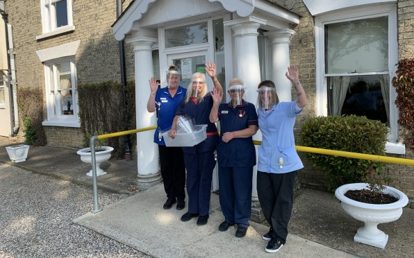 Mansion House care staff donning their new face shields