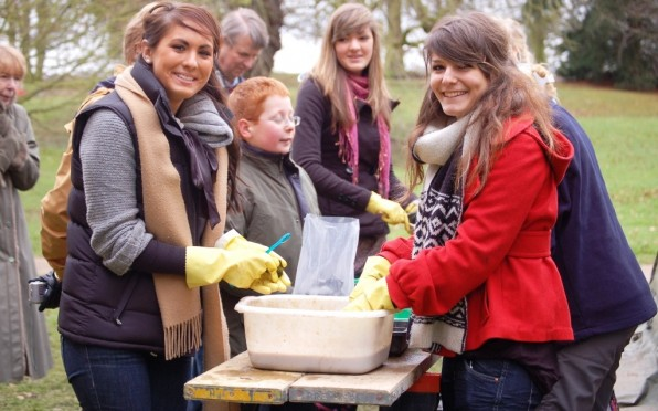 Students helping clean artifacts