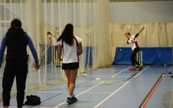 Girls batting in the Sports Hall