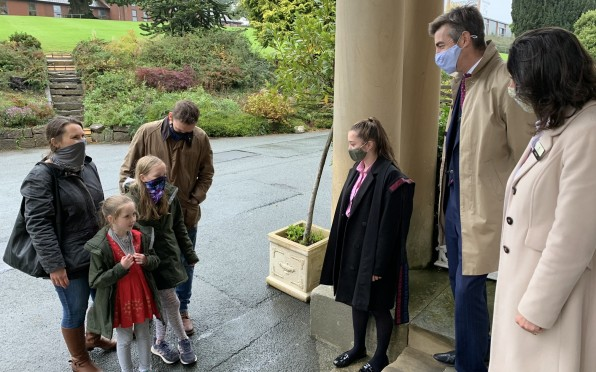 The Headmaster, Mrs Noad, and Head Girl meet a prospective family