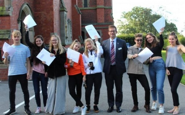 A Level students celebrating their success with Ed Hester (Headmaster)