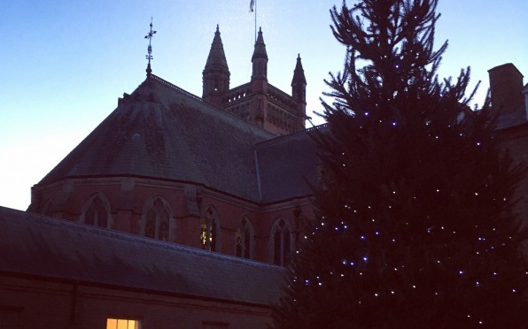 Image of the Christmas Tree in the Quad with the Chapel behind
