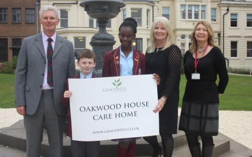 Winning pupils Kiah and Michael with Headmaster Jonathan Cramb and Amanda Scott, Gracewell Healhcare