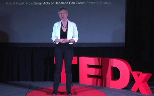Yang-May giving a talk for TEDx