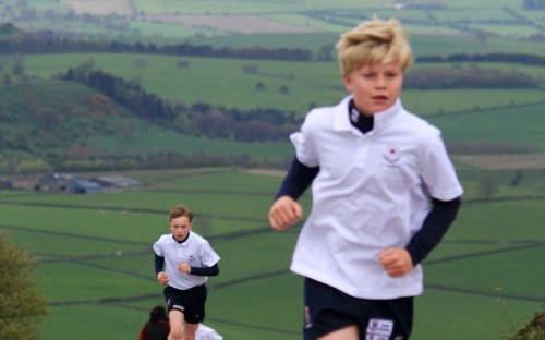 Participants race for the finish line at Curbar Gap