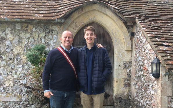 Chris Savage with his son outside St Peter's Chapel at Seaford College