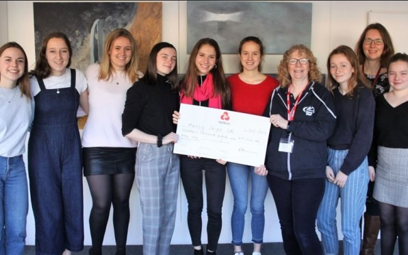 Presenting the cheque: The St Helen and St Katharine charity reps