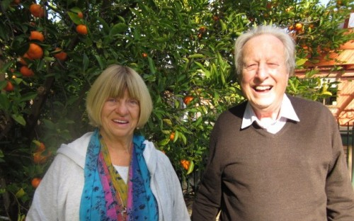 This is a current picture of my wife, Sandy, and me framed by the mandarin tree in our garden.