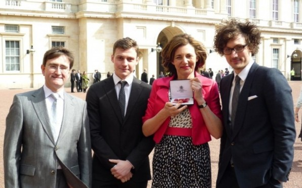 Receiving her OBE award at Buckingham Palace