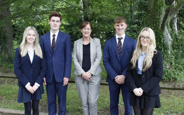 Our newly appointed Head Students with Ms Merricks, Head of Sixth Form