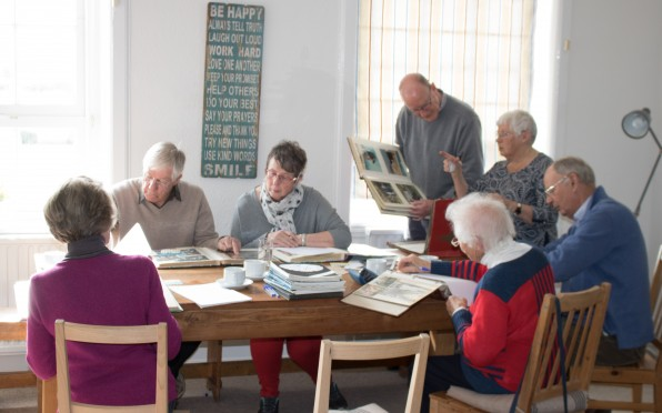 Former teachers hard at work in the boarders' common room