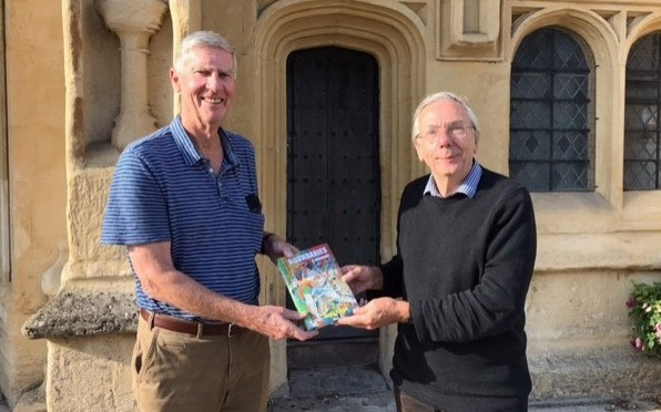 Roger being handed the first copy of the book by Stephen Chalke, a well-known cricket writer.