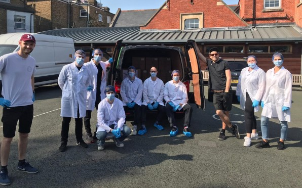 Bloom & Wild delivery guys helping Augment Bionics deliver facial shields to Charing Cross Hospital